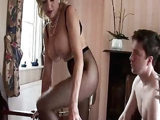 Brit Mummy Taunts Youthfull Lad With Her Tits